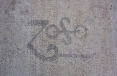 Sandblasted stencil on sidewalk near entrance.